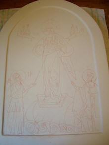 Design carved onto gesso surface