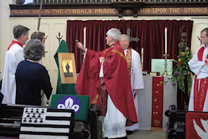 Father Gareth blesses the icon of St Bartholomew in the Anglican Church in Dinard